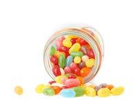 软心豆粒糖糖果溢出在瓶子外面 图库摄影