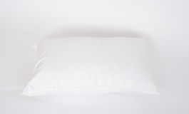 软性和卫生学把伟大枕在白色隔绝的您的卧室的 库存图片