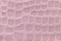 从软的室内装饰品纺织材料,特写镜头的桃红色背景 与模式的织品 免版税库存图片