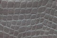 从软的室内装饰品纺织材料,特写镜头的灰色背景 与模式的织品 免版税库存图片