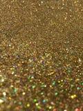 软的焦点金子闪烁闪闪发光背景 免版税库存照片