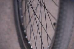 软的焦点,美好的bokeh,一部分的自行车的前轮 库存照片