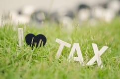 软的神色图象概念特写镜头白色木字母表我爱税 库存图片