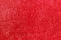 软的红色微羊毛毯子背景 免版税图库摄影