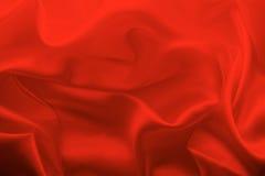 软的红色织品纹理背景,被弄皱的缎背景 库存照片