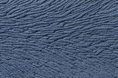 从软的纺织材料的浅兰的背景 与自然纹理的织品 库存照片