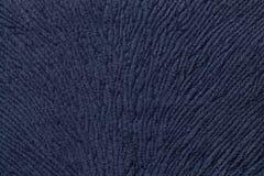 从软的纺织材料的深蓝背景 与自然纹理的织品 库存图片