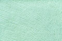 从软的纺织材料的薄荷的背景 与自然纹理的织品 免版税库存照片