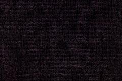从软的纺织材料的黑背景 与自然纹理的织品 免版税库存图片