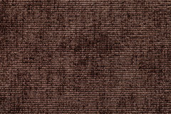 从软的纺织材料的黑褐色背景 与自然纹理的织品 免版税库存图片