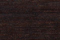 从软的纺织材料的黑褐色背景 与自然纹理的织品 免版税库存照片