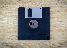软盘磁性在一张木桌上 免版税库存照片