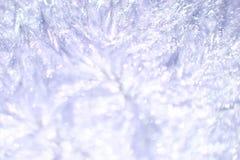 软绵绵地蓝色被弄脏的迷离的闪闪发光和紫罗兰色棕榈蜡背景 免版税库存图片