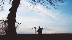 软绵绵地集中 死亡日落剪影 死亡的概念 库存图片