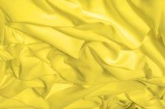 软绵绵地集中 纹理,样式 织品柔滑的黄色,太阳金黄 免版税库存图片