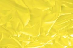 软绵绵地集中 纹理,样式 织品柔滑的黄色,太阳金黄 免版税图库摄影