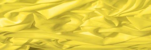 软绵绵地集中 纹理,样式 织品柔滑的黄色,太阳金黄 库存图片
