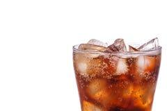 软饮料的玻璃 背景查出钳子射击工作室白色 免版税库存图片