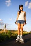 轴向直排轮式溜冰鞋冰鞋妇女 免版税库存照片