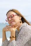 轻松的高级妇女纵向  免版税图库摄影
