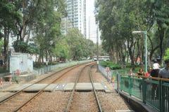 轻的路轨运输在屯门hk 图库摄影