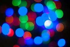 轻的闪烁葡萄酒背景, bokeh背景, defocused 生日快乐,情人节,圣诞灯 免版税库存图片