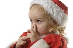 辅助工他的鼻子挑选圣诞老人 库存图片