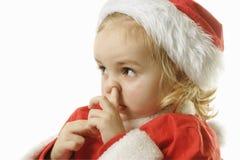 辅助工他的鼻子挑选圣诞老人 免版税库存照片