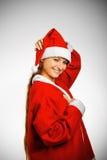 辅助工俏丽的s圣诞老人 库存图片