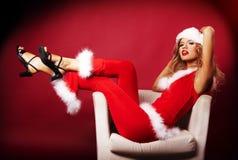 辅助工性感的圣诞老人 库存图片