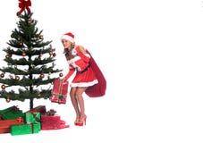 辅助工s性感的圣诞老人 免版税库存图片