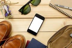 辅助部件移动与护照,花,鞋子, mobilepho 库存图片
