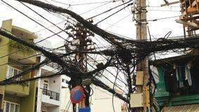 输电线网在街道胡志明市上的 免版税图库摄影