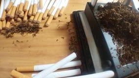 辗压香烟 库存图片