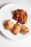 辣土豆薄烤饼和豆 免版税库存图片