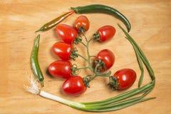 蕃茄、葱和胡椒 免版税库存照片