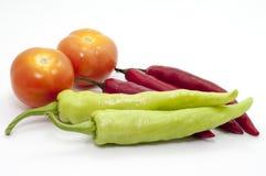 辣椒和蕃茄在焦点 免版税图库摄影