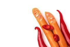 辣椒和香肠在框架iso的右边 免版税库存照片