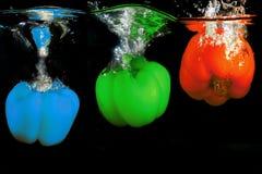 辣椒的果实果子飞溅水RGB颜色 免版税库存图片
