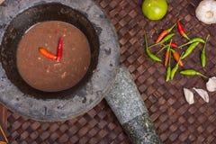辣椒酱和鸡蛋用油煎的鲭鱼 库存照片