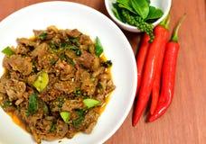 辣油煎的公猪泰国食物 免版税库存照片
