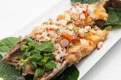 辣油煎的鱼 免版税图库摄影