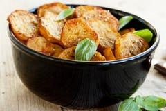 辣被烘烤的土豆 免版税库存照片