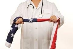 辩论医生标志对使用的医疗保健改革 库存照片