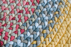 从辫子的五颜六色的地毯作为背景 免版税库存照片