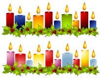 边界蜡烛圣诞节霍莉花圈 库存图片