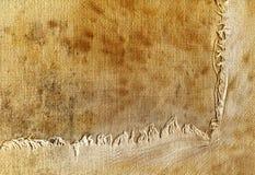边缘被撕毁的织品老 库存照片
