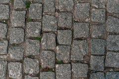 边路纹理-照片石头被铺的道路  免版税库存照片