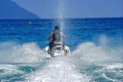 迅速的滑行车飞溅水 免版税库存图片
