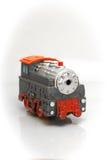 迅速移动的灰色红色玩具火车 库存照片